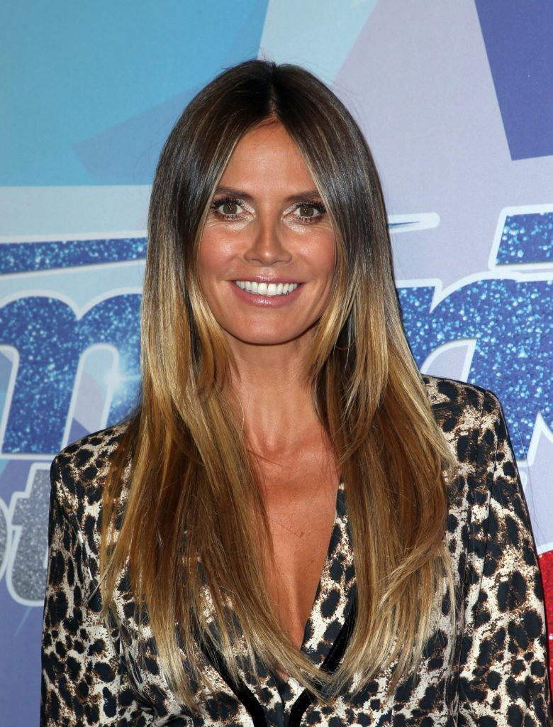 model heidi klum with long straight golden brown balayage hair