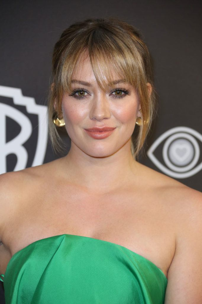 actress hilary duff with a blonde wispy fringe