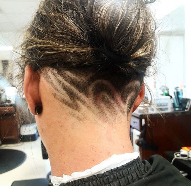 brown hair in bun with pattern undercut at nape of neck