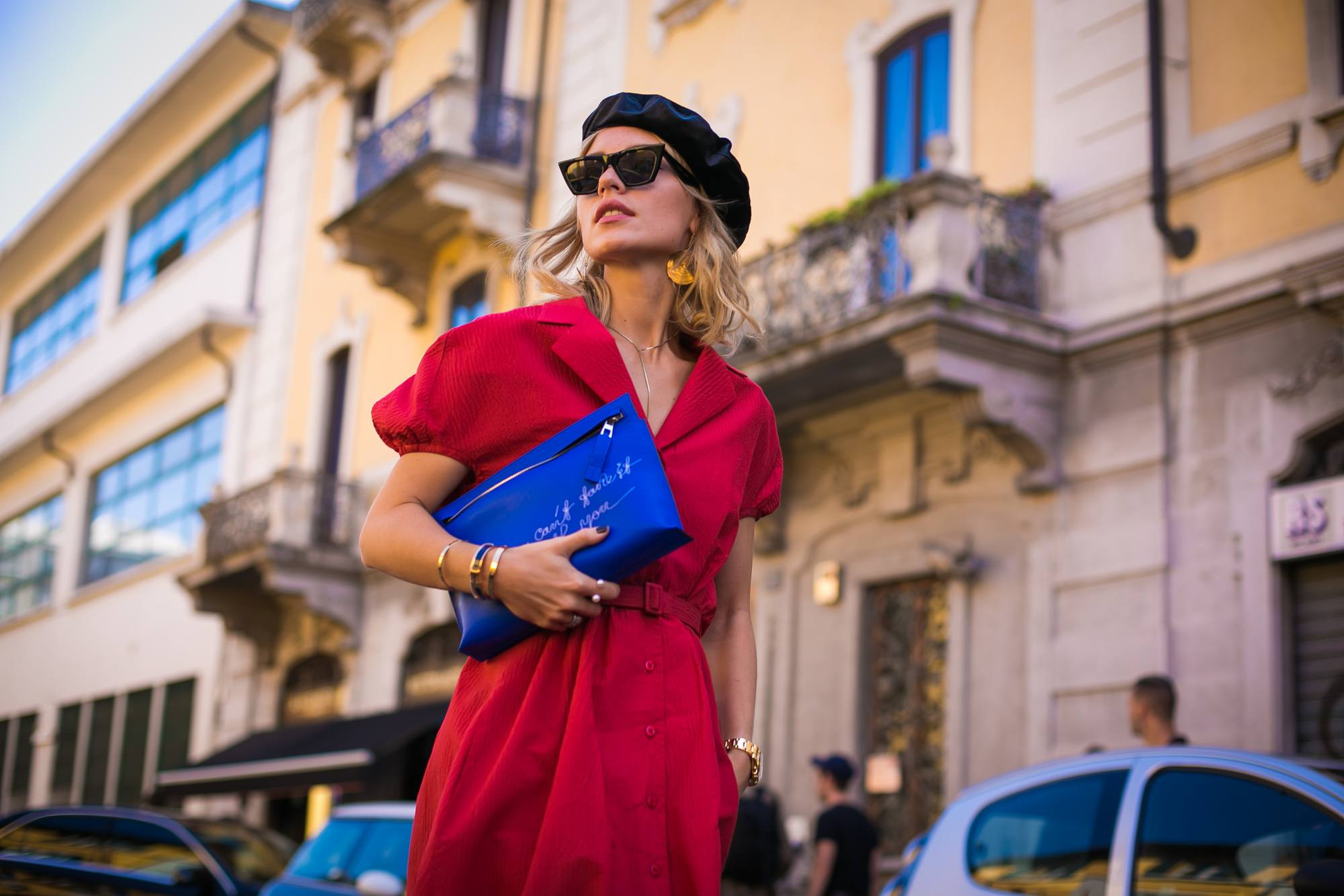 blonde street styler at milan fashion week in a red tea dress and black beret