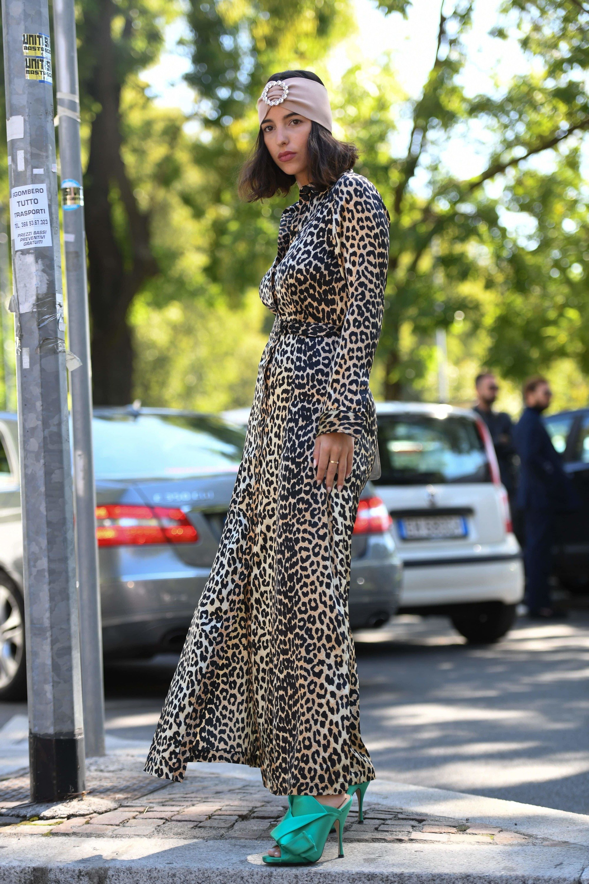street styler at milan fashion week in a long maxi dress and embellished hair wrap