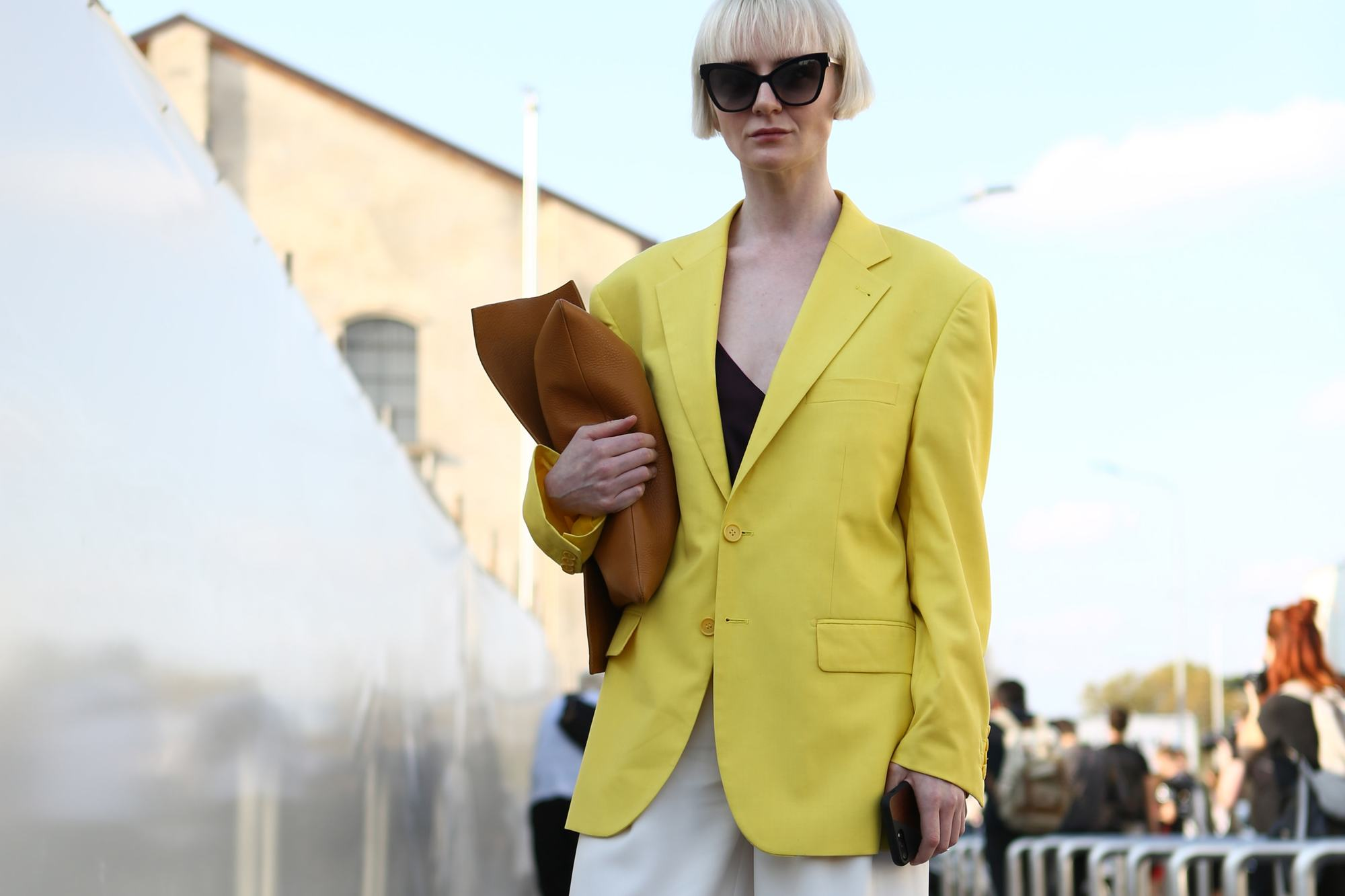blonde street styler at milan fashion week ss18 in a yellow blazer with a short bob cut