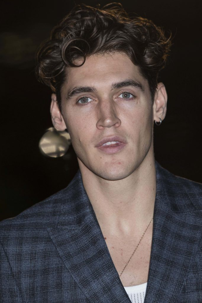 close up shot of isaac carew with curly quiff hairstyle and checked suit on the GQ Men of the Year Awards