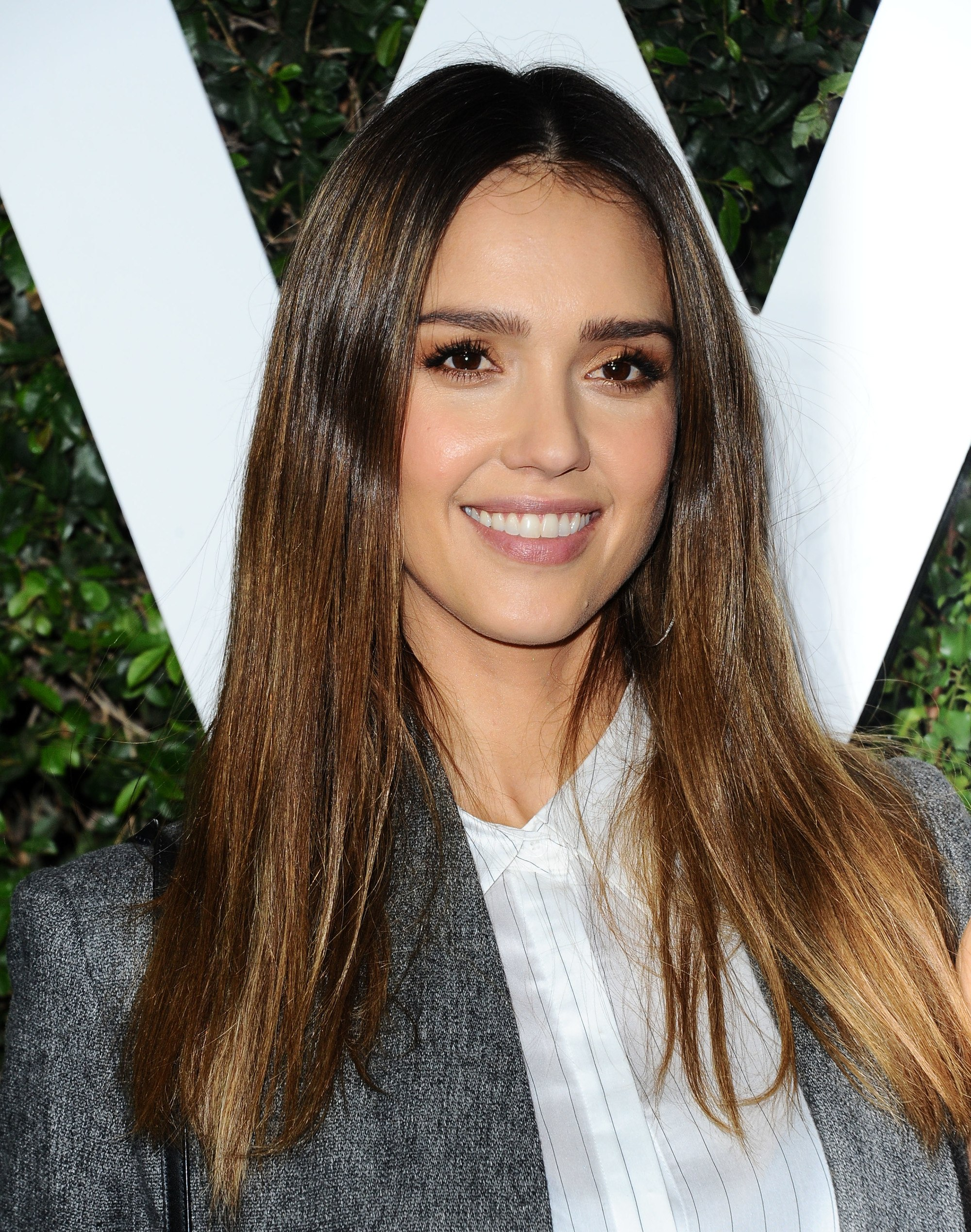 actress jessica alba with long straight toffee coloured balayage