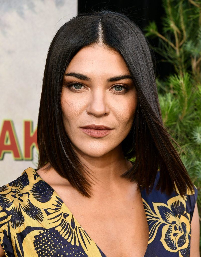 close up shot of jessica szohr on the red carpet with sleek a line cut lob hairstyle
