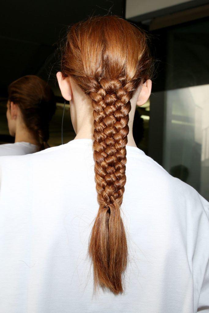 backshot of model at jil sander with 5 strand braid hairstyle at milan fashion week