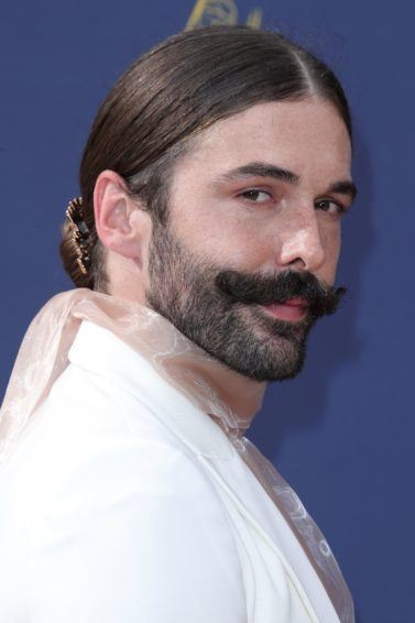 Queer Eye star Jonathan Van Ness at the 2018 Emmy Awards with a sleek low bun hairstyle and facial hair