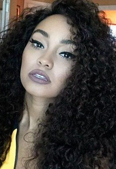 close up of leigh anne pinnock with big wild curls
