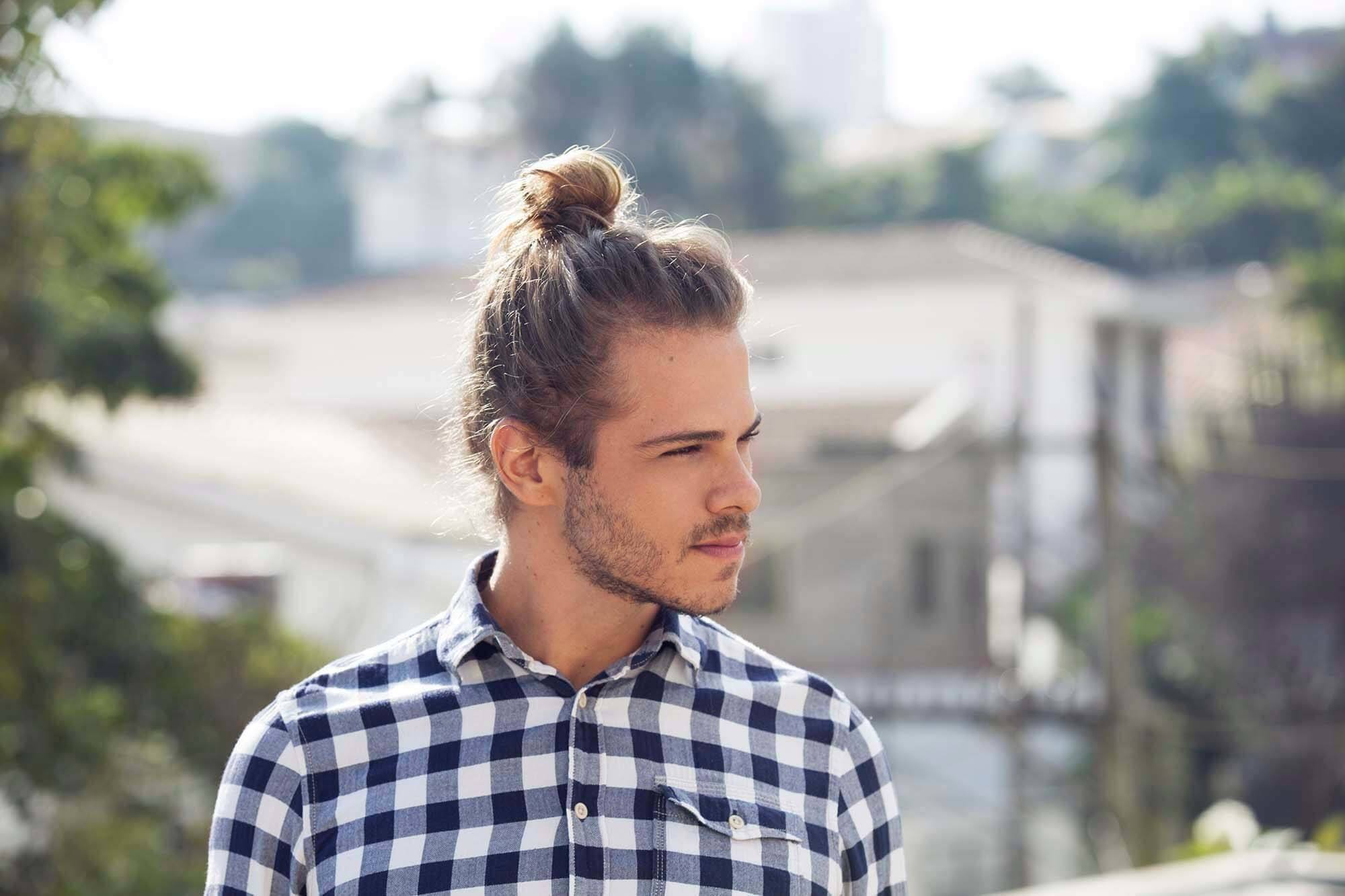 male model with blonde hair with high man bun