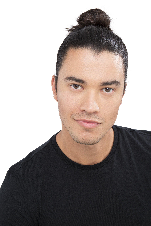 asian model with black hair in high man bun