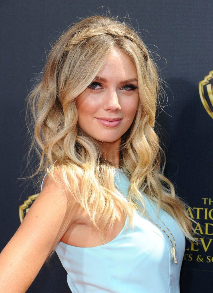head shot of melissa ordway with half up party braids and beachy waves hairstyle, wearing blue on the red carpet