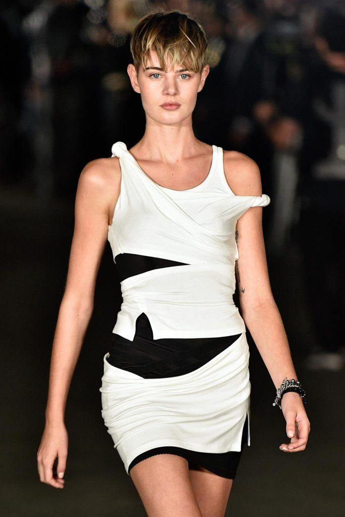 model with blonde pixie hair with fringe finish on runway NYFW