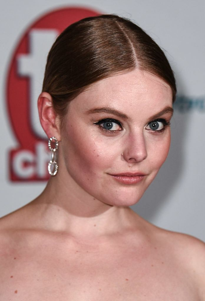 Victoria actress nell hudson with her hair in a sleek centre parting