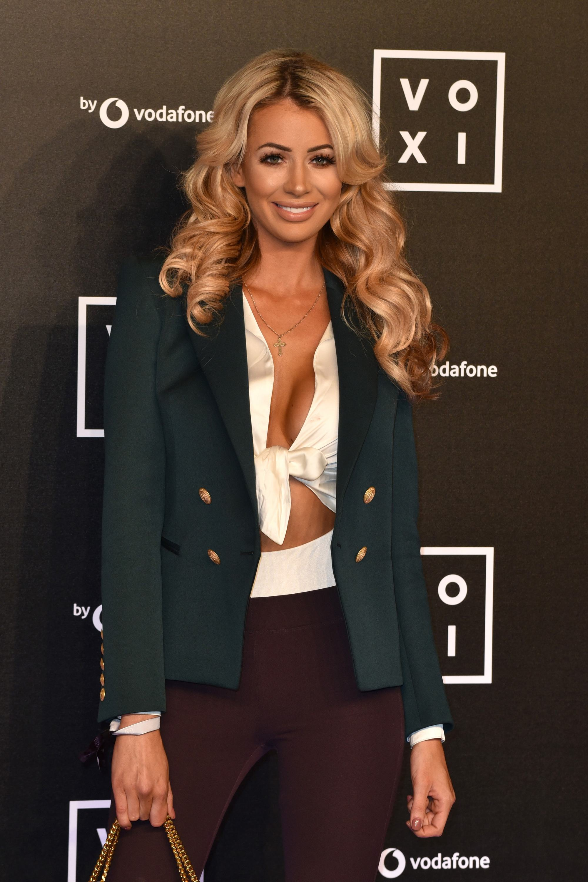 love island star olivia attwood with her blonde hair in glamorous curls