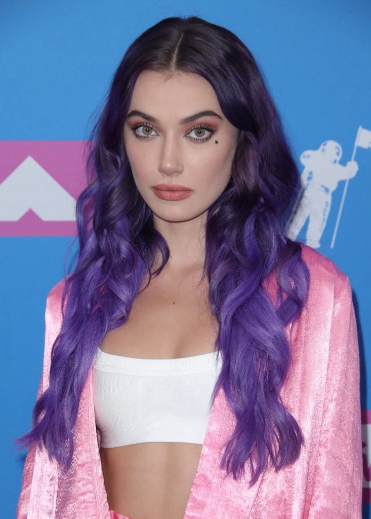 Close up shot of Olivia O'Brien with long, curly dark brown hair with purple ombre ends on the VMA red carpet.