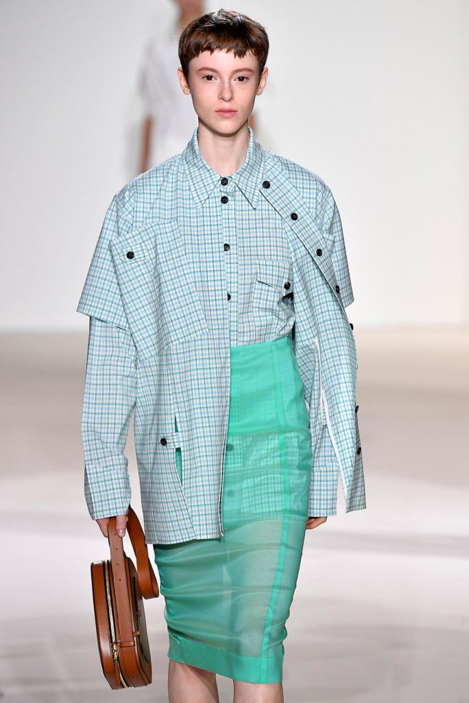 model on NYFW runway with brown hair short pixie cut