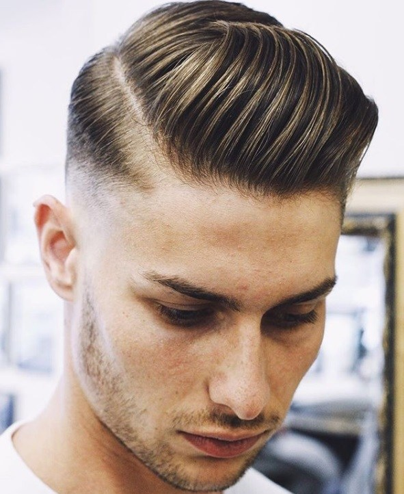 close up of man with undercut slicked back hair with a side part top, at