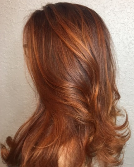 side profile of a woman with pumpkin spiced latte auburn hair