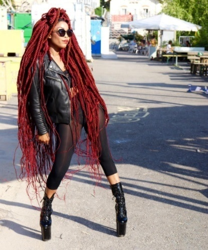 woman with ultra long red braided hair