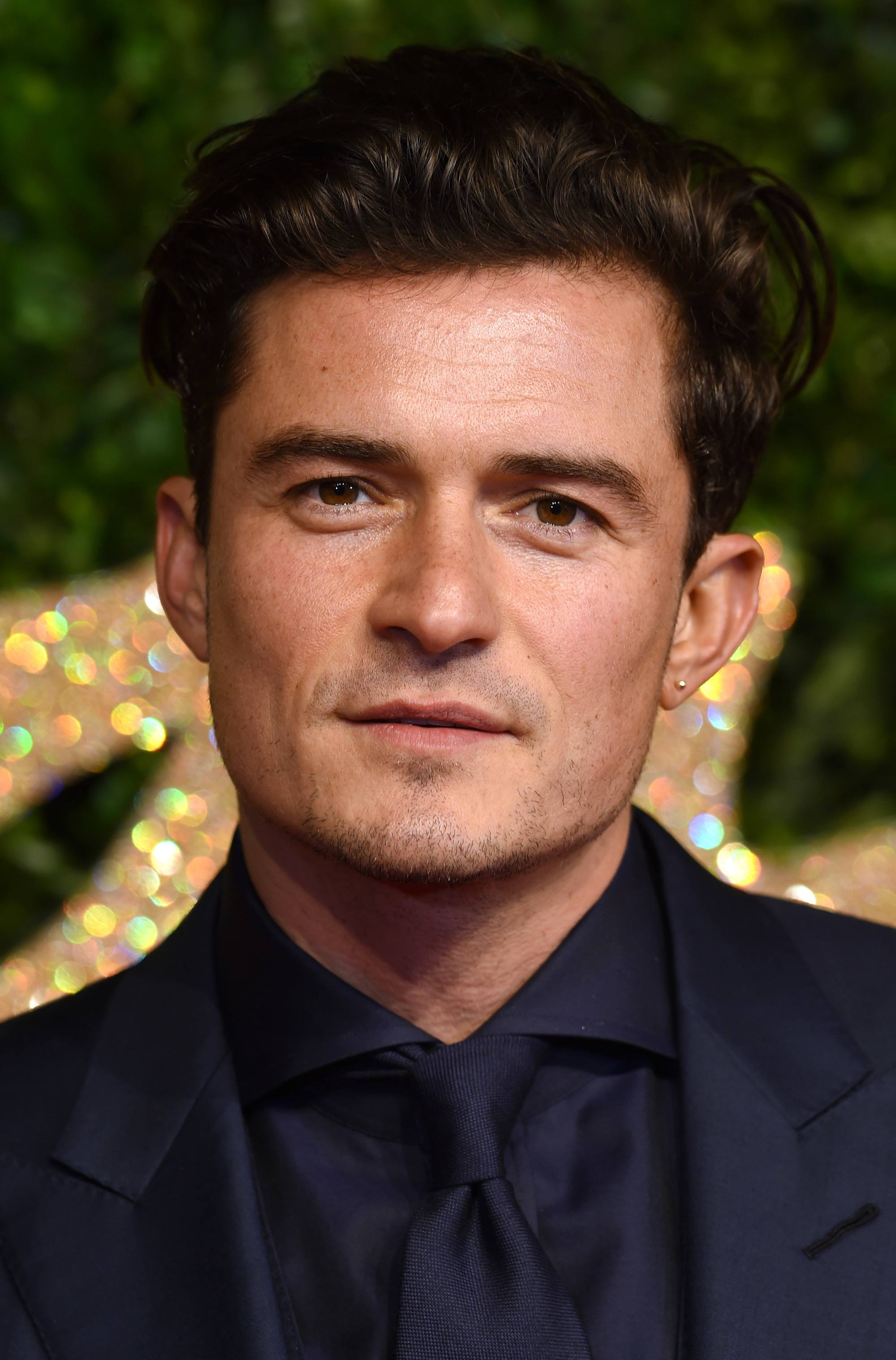 orlando bloom with swept back dark hair