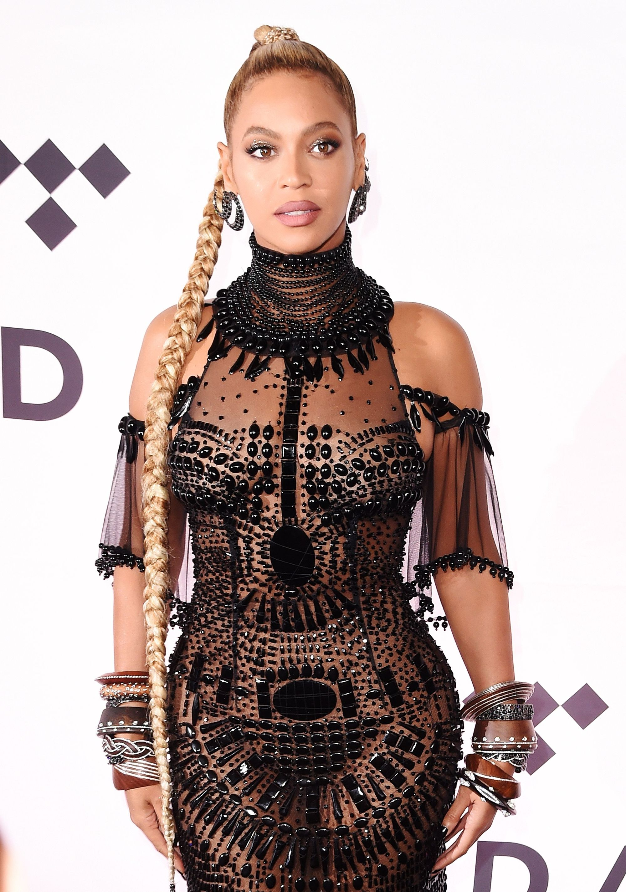 Beyonce with extra long rapunzel blonde hair in high ponytail braid