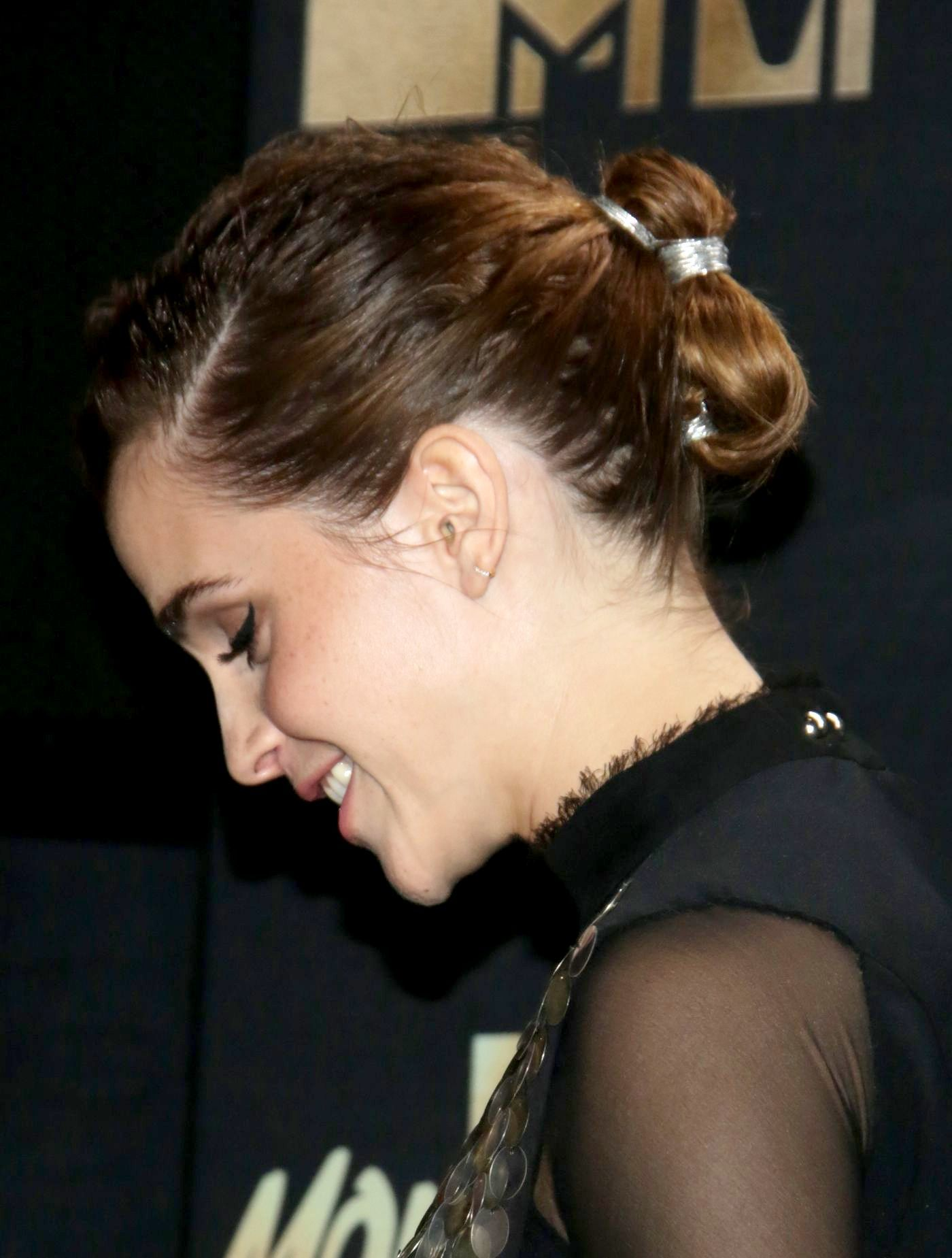 Emma Watson brown hair in smoothed back double bun updo