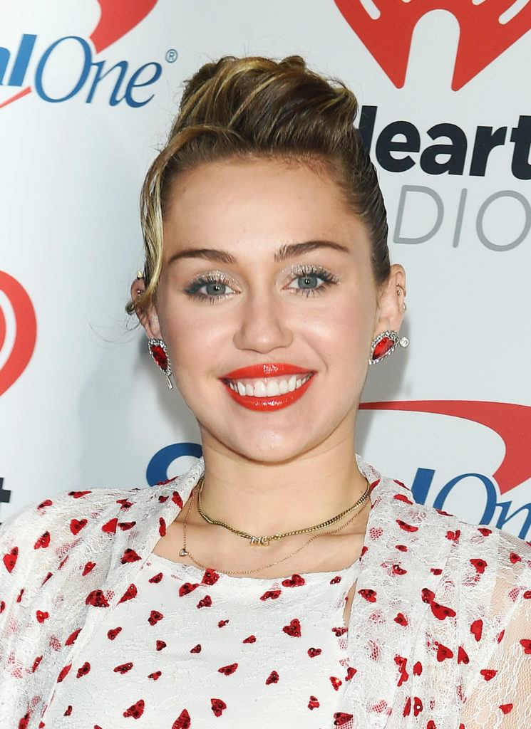 Miley Cyrus dirty blonde hair in quiff updo