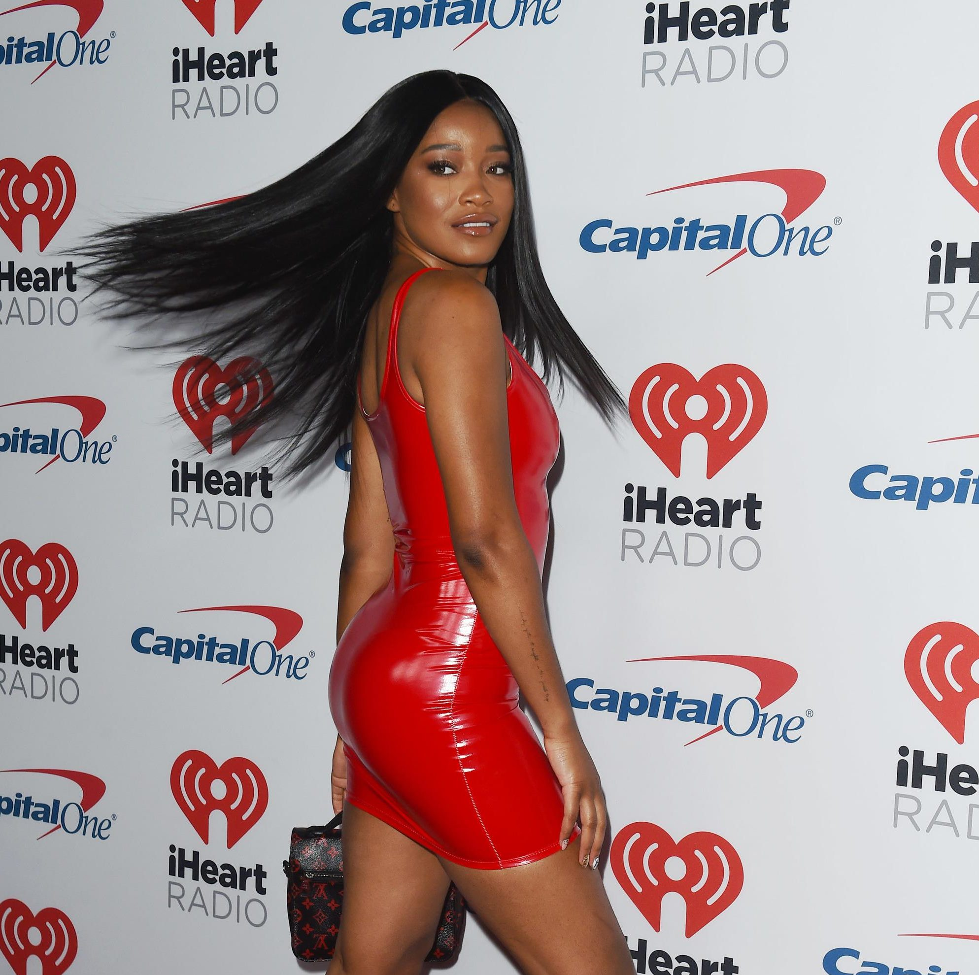 Keke Palmer swishing her long black straight hair