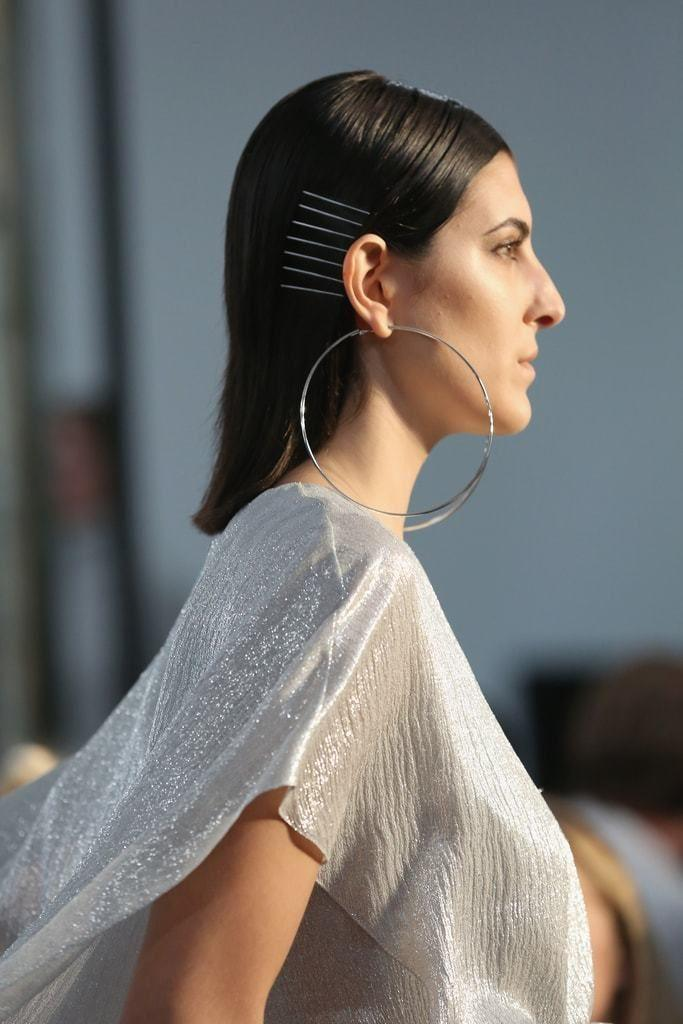 woman on the runway of sally la pointe ss18 with silver accessories and sleek brunette hair