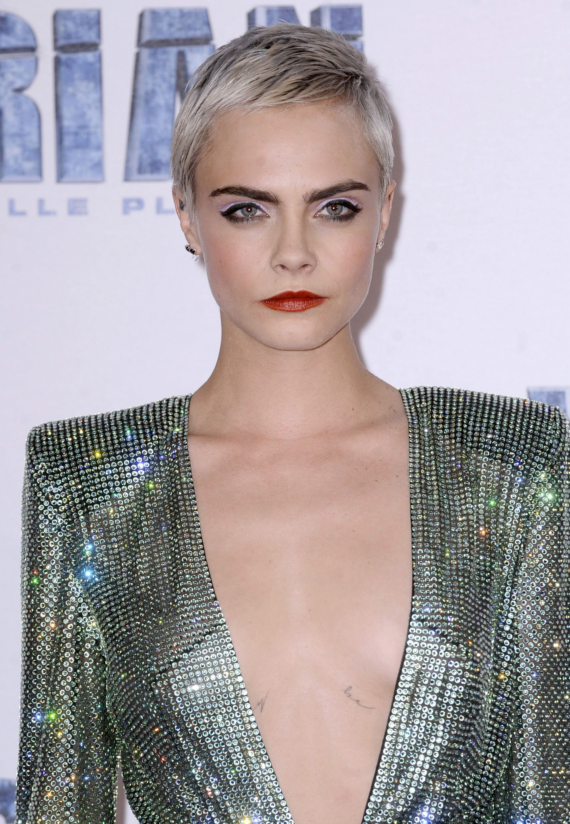 permanent silver hair dye: close up shot of cara delevingne on the valerian red carpet with silver grey hair