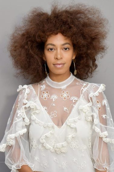 shot of solange knowles with auburn afro hair style