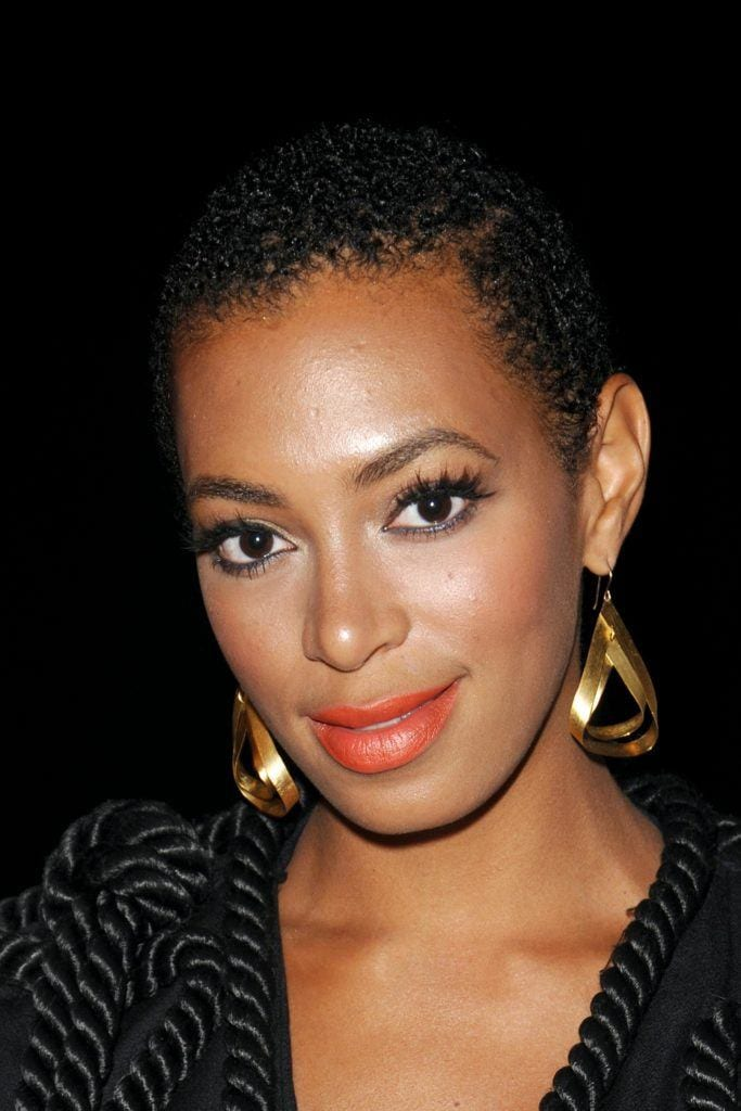 close up shot of the solange knowles on the red carpet with a small twa