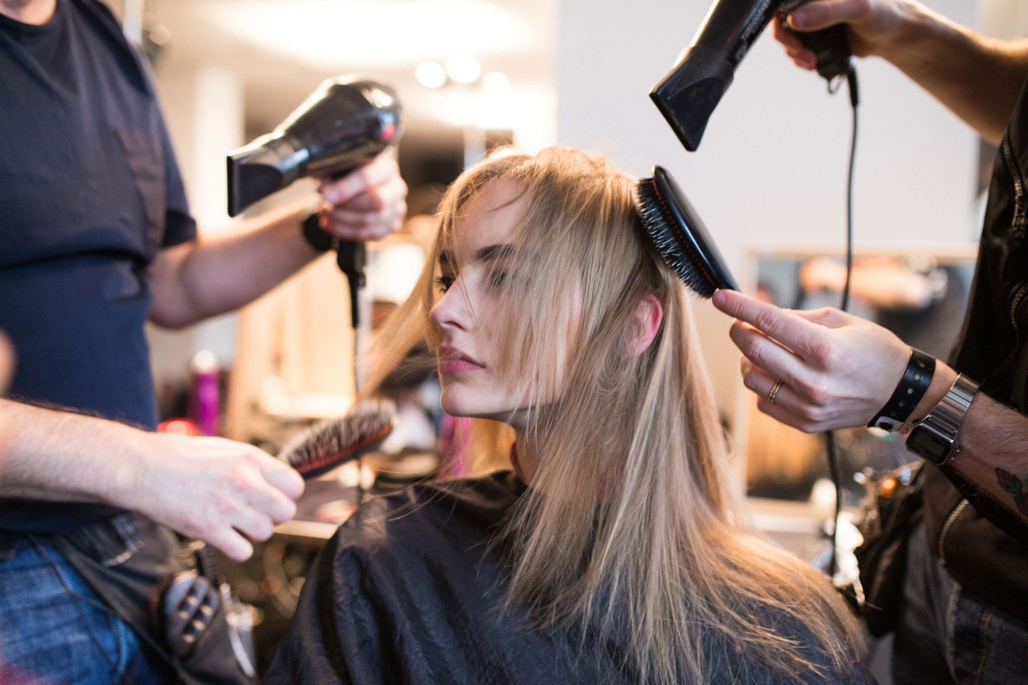 curl straightened hair: shot of model getting her hair straightened and blow dried at etro fw16