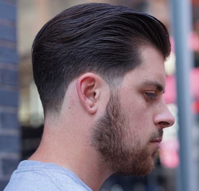 side view of swept back brown hair with shadow taper finish