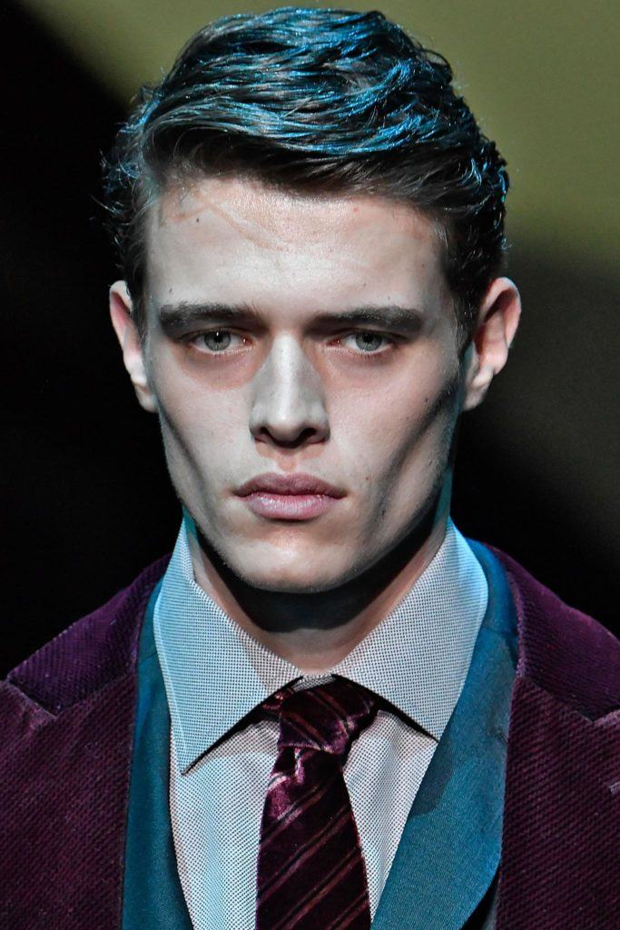 male model on the runway with textured side slick hairstyle wearing purple blazer