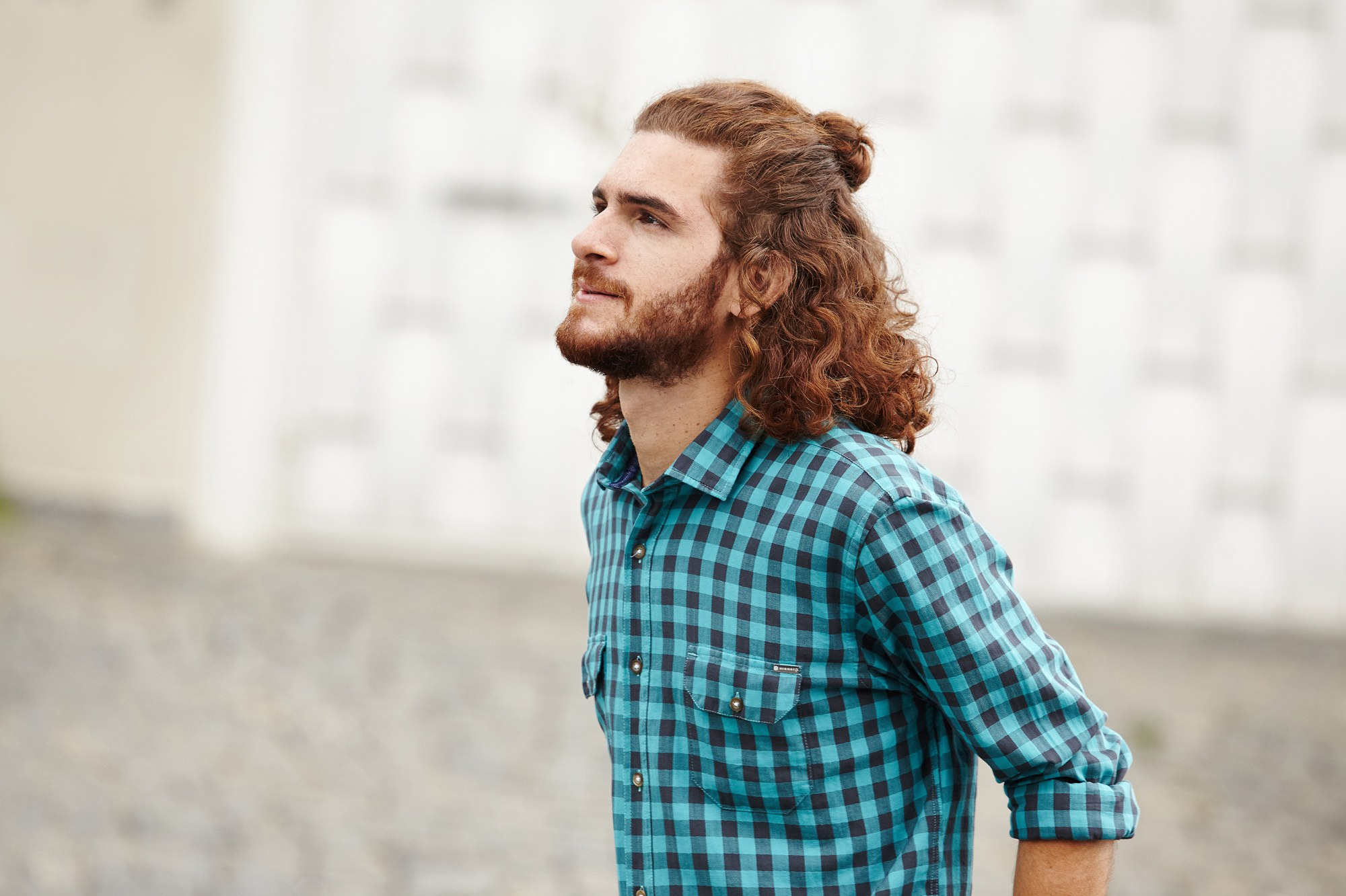 male model with ginger hair with half-up, half-down man bun
