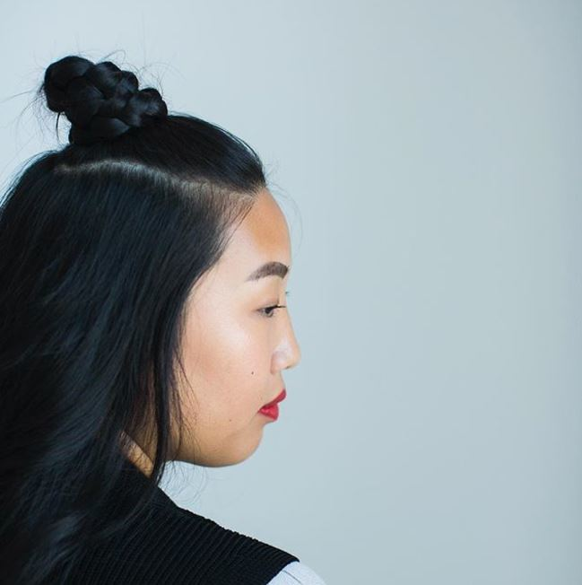 side view of black hair with half-up braided top knot