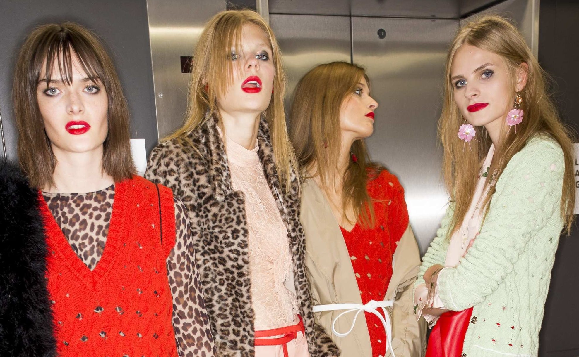 four models backstage at runway show with straight hair Topshop Unique