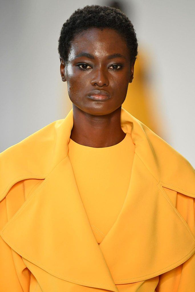 model on NYFW runway with short afro style