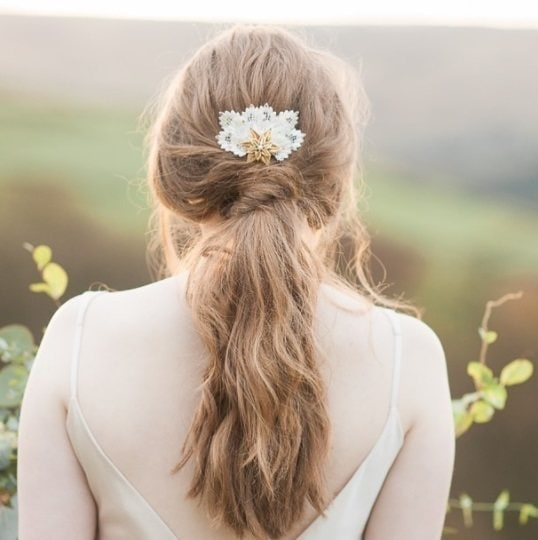 back shot of a brunette woman with her hair in a twisted low ponytail