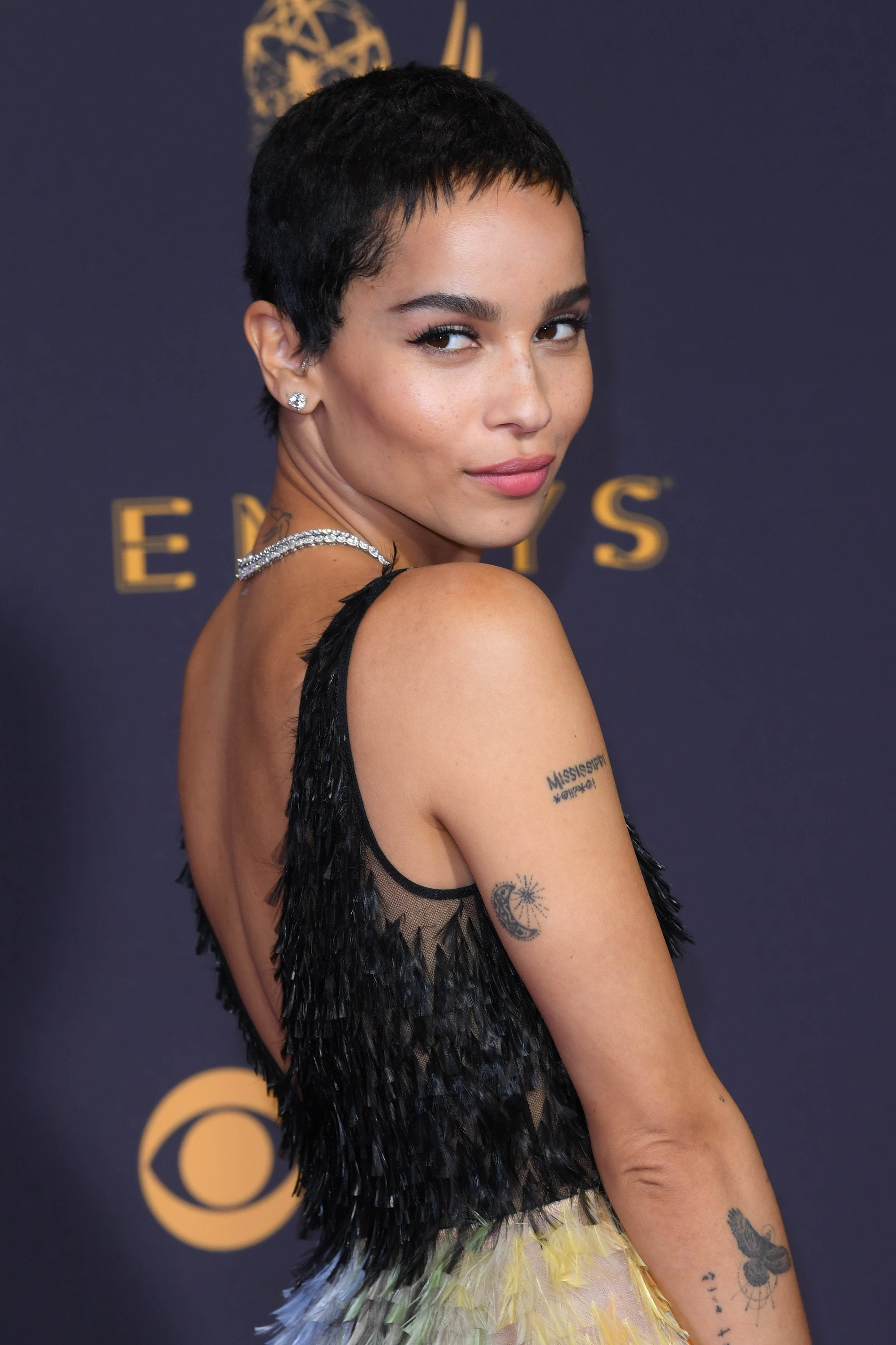 side shot of zoe kravitz with pixie cut