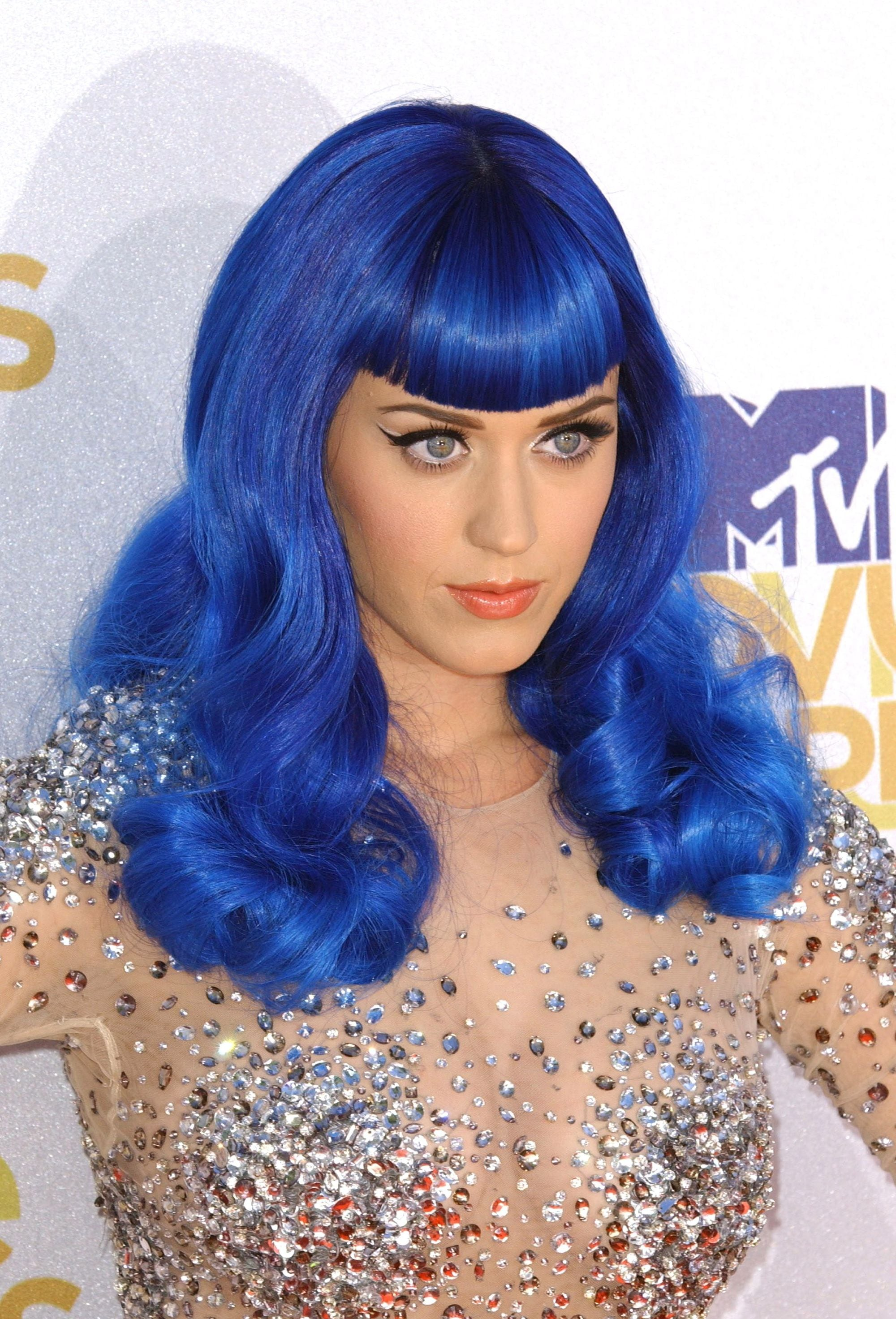 Katy Perry electric blue medium length hair with curved full bangs