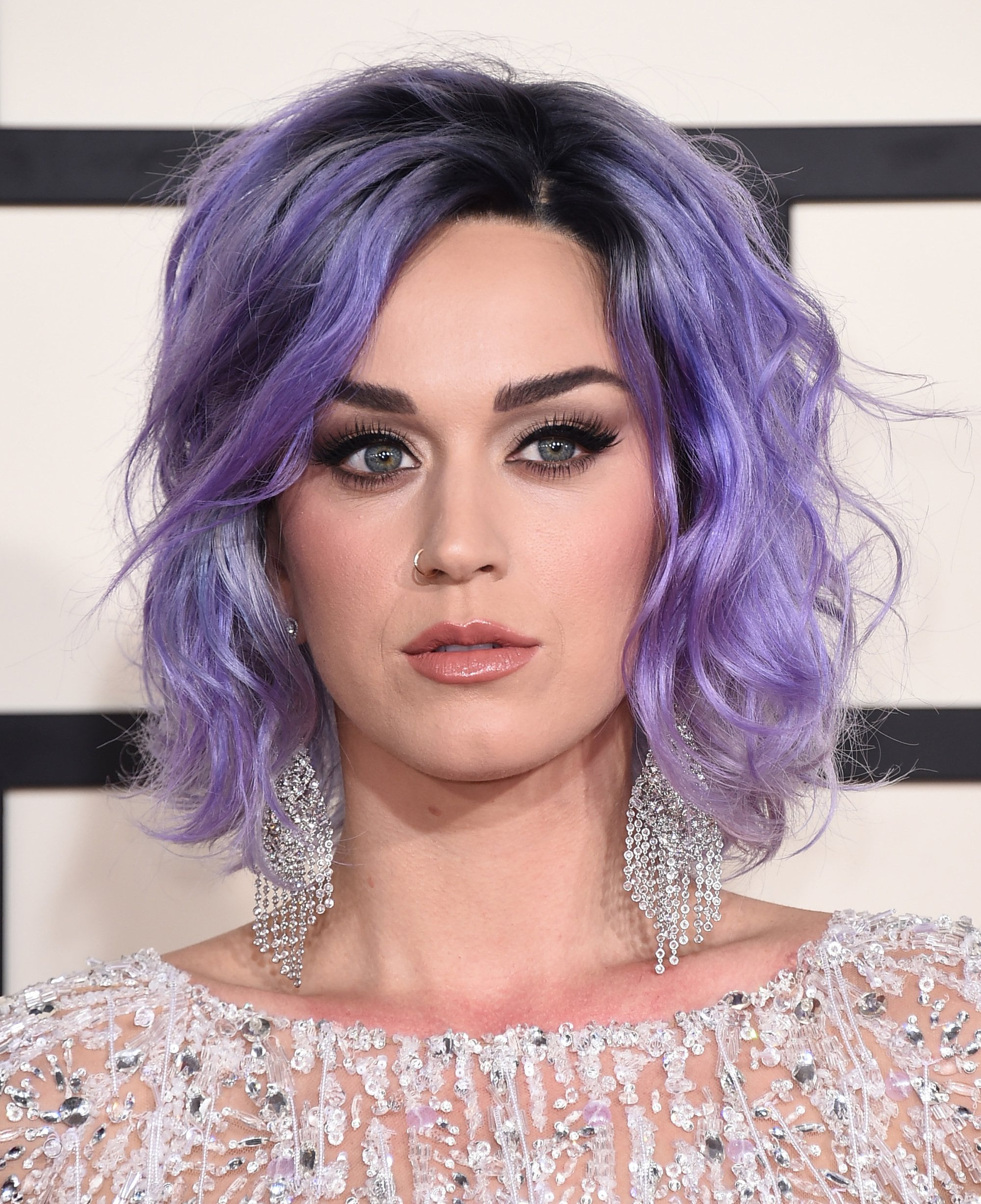 Katy Perry long bob purple hair colour with black roots and wavy finish