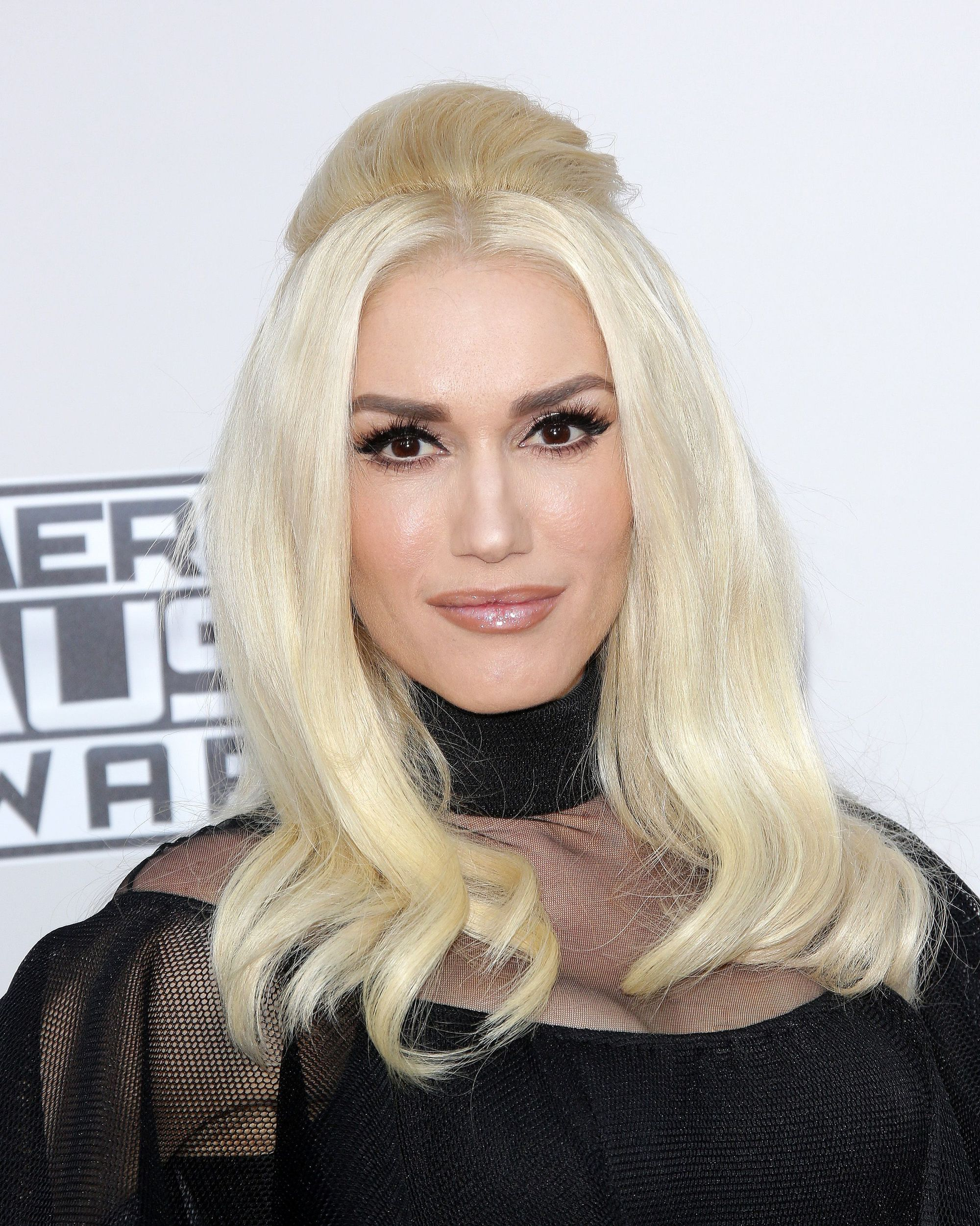 Gwen Stefani medium length platinum blonde hair in half-up, half-down style