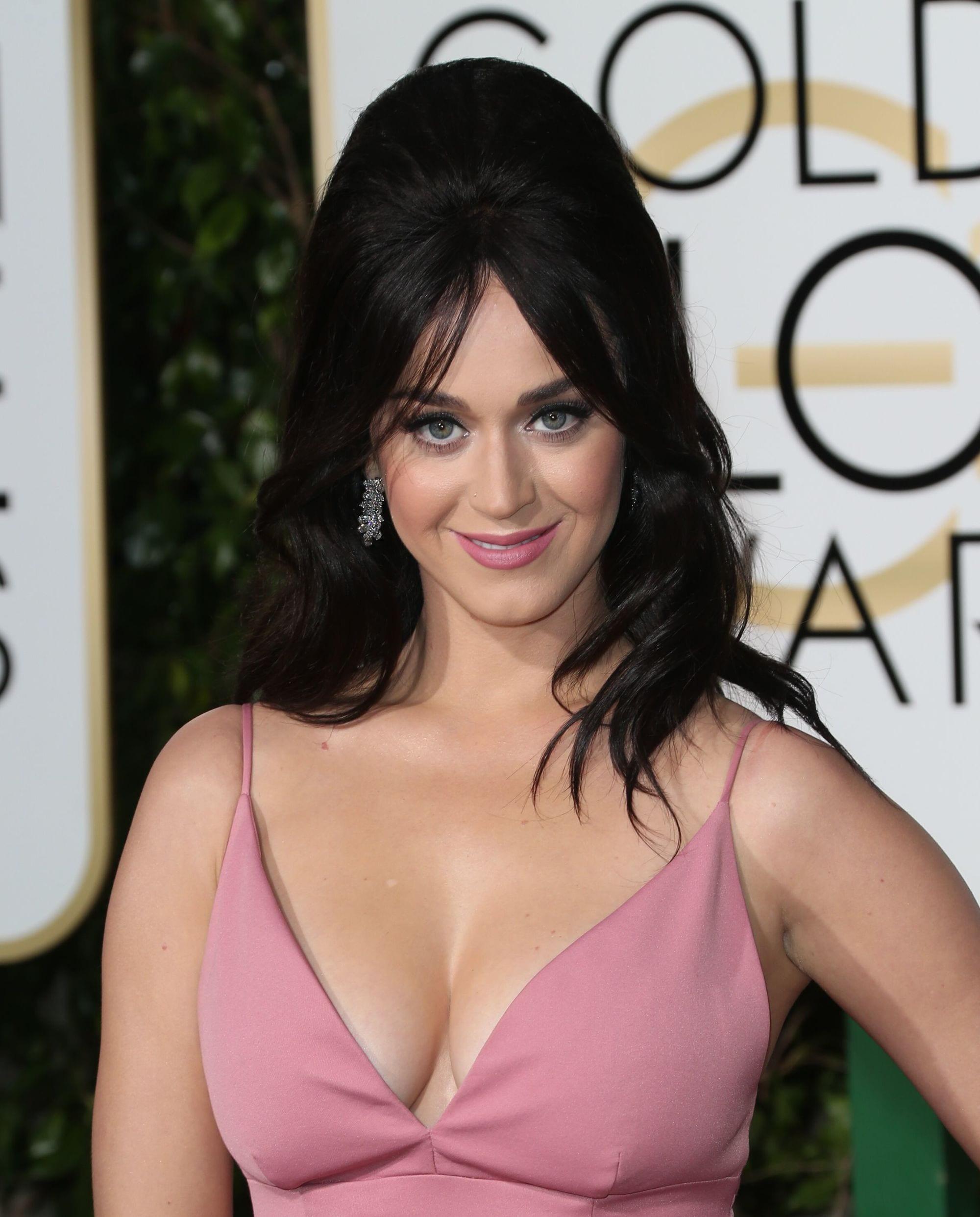 Katy Perry black hair in half-up, half-down '60s inspired bardot bangs