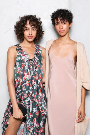 type 3 hair guide: shot of two models with curly hair posing at the CFDA x Vogue Fashion fund event
