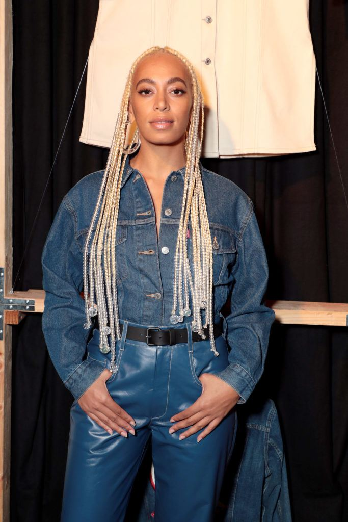 Loose box braids: Close up shot of Solange Knowles with long, platinum box braids with loose ends, that have chandelier hair accessories attached to them.