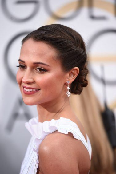 swedish actress alicia vikander at the 2016 golden globe awards with her dark hair in an updo