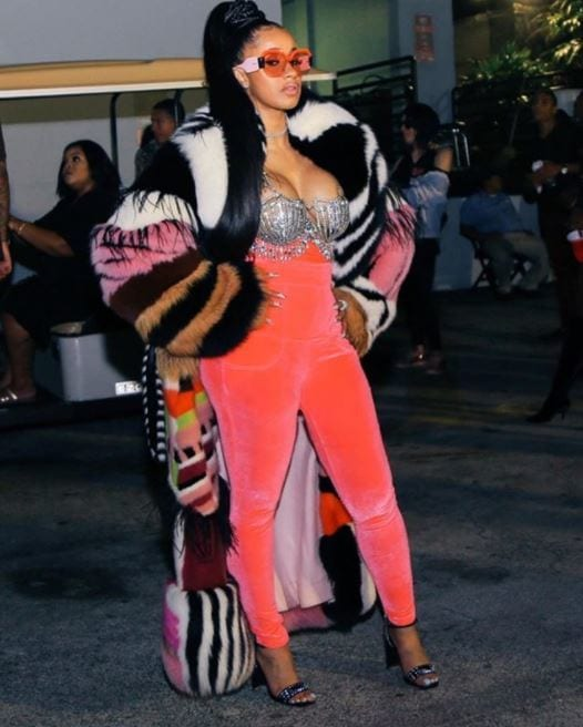 Cardi B long black rapunzel hair in high ponytail with braids wrapped around the base of ponytail