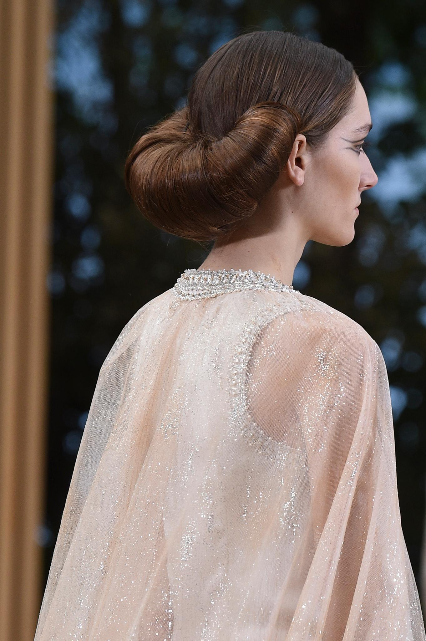 backshot of model on the chanel runway with a crossiant bun hairstyle